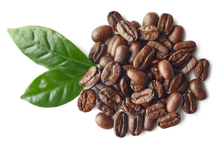 Heap of roasted coffee beans and leaves isolated on white background, top view