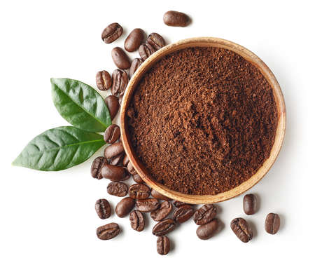 Bowl of ground coffee and beans isolated on white background, top view