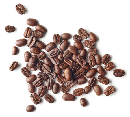 Heap of roasted coffee beans isolated on white background, top view