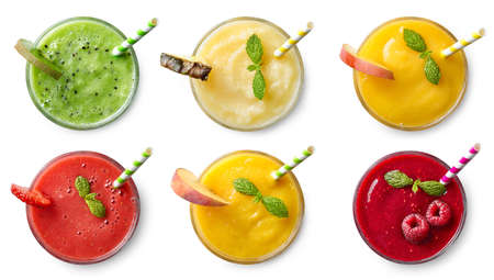 Set of various fresh fruit smoothies isolated on white background. Top view Banco de Imagens