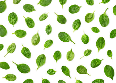 Pattern of fresh spinach leaves isolated on white background. Top view