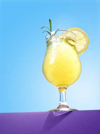 Glass of yellow lemon spritzer cocktail with rosemary on blue background Banco de Imagens