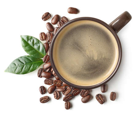 Cup of black coffee and beans with leaves isolated on white background, top view