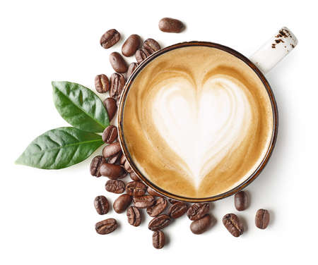 Cup of coffee latte or cappuccino art with heart shape drawing and beans isolated on white background