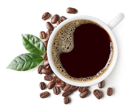 Cup of black coffee with beans and leaves isolated on white background, top view