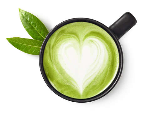 Cup of green tea matcha latte with heart shaped art isolated on white background, top view