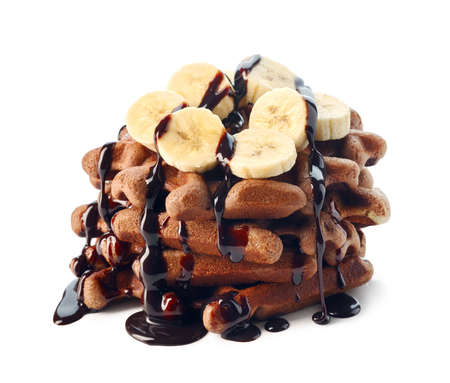 Belgium waffles with chocolate sauce and banana slices isolated on white background