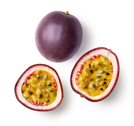 Set of whole and half of fresh passion fruit isolated on white background, top view Stockfoto