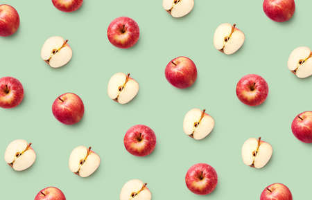 Colorful fruit pattern of fresh red apples on light green background Imagens