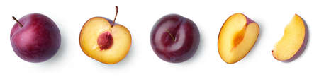 Set of fresh ripe whole, half and sliced plum isolated on white background, top view Imagens