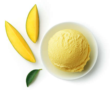 Bowl of yellow mango ice cream scoop or ball isolated on white background, top view Imagens