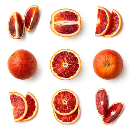 Set of fresh whole, half and sliced red blood orange fruit isolated on white background, top view