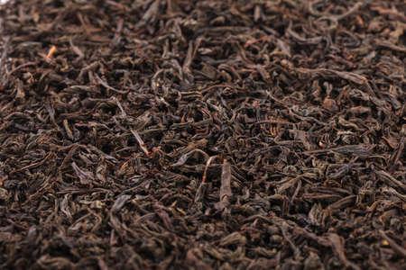 Dried tea leaves. Large leaf black tea. Close-up.