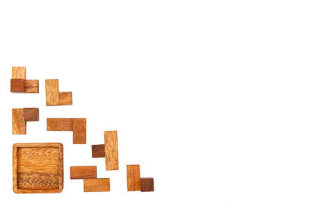 A wooden puzzle is a cube. In the decomposition into elements. Isolated on white background. Not solved Close-up.