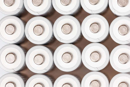 AA batteries are close to each other. Close-up of white batteries on a white background. Battery technology. 스톡 콘텐츠