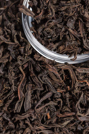 Dried tea leaves. Large leaf black tea. Close-up.