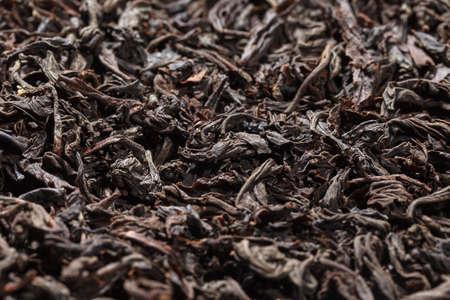 Dried tea leaves. Large leaf black tea. Close-up. Stock fotó - 156595659