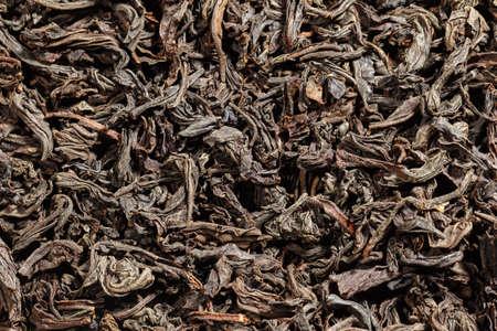Dried tea leaves. Large leaf black tea. Close-up. Stock fotó - 156665758