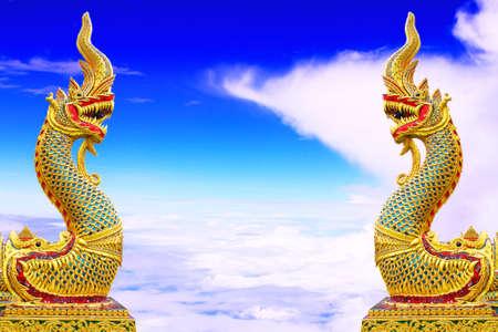 naga china: Twin Thai dragon or king of Naga statue on blue sky background