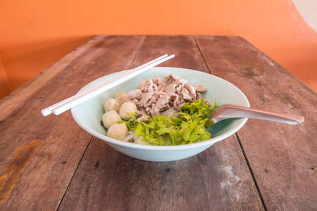Pork noodle on a wooden table photo
