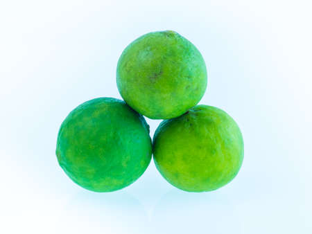 Green lemon on white background, Stock Photo