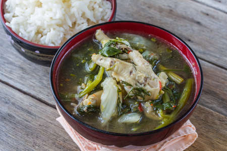 Curry Chicken Thai Curry with wooden background Stock Photo