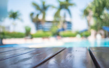Blur wooden table on pool background, selection focus shameless wooden table, Stock fotó