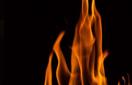 Beautiful yellow fire flames on black Stock Photo