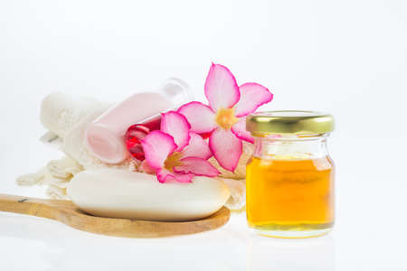 Spa products on light wooden background, spa products on white background, total spa products, soap in spa on white, honey in bottle on white,