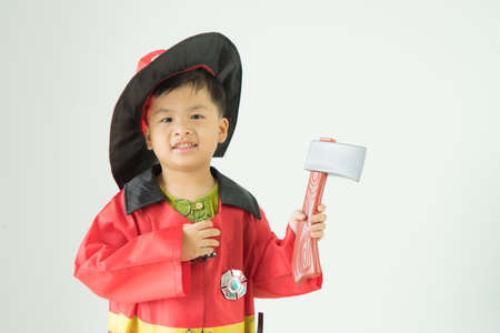 Children wearing fire extinguishers holding axe on white background,