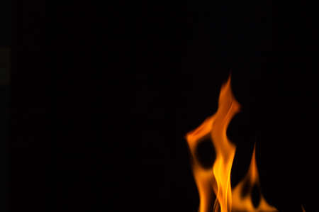Beautiful fire flames, isolated on black background,
