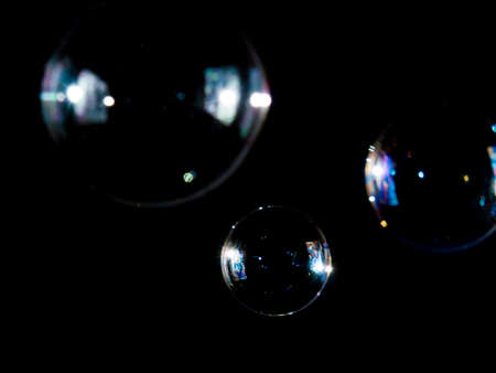 soap bubbles on black background, Photo of soap bubble,
