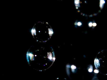 Blurred soap bubbles on black background, Photo of soap bubble, soap bokeh background,