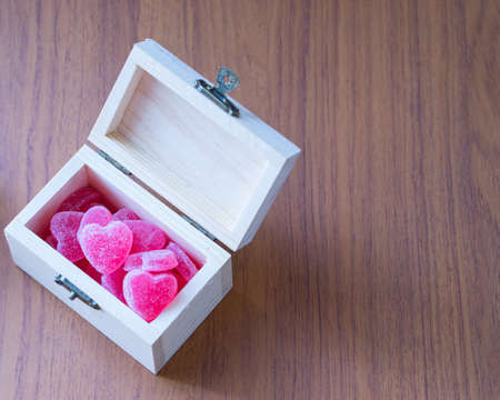 Blurred Sweet candy heart in box wooden