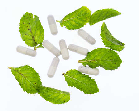 White medicine and raw mint color on white background, Banco de Imagens