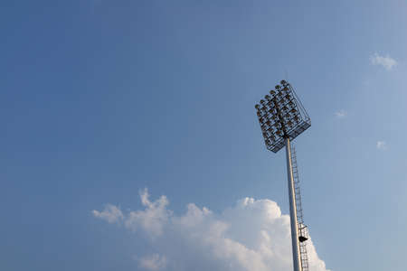 Sport light on the white clouds background,