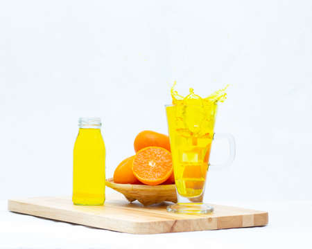 Yellow orange juice in the glasses and bottle on white background,