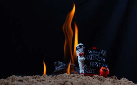 Label welcome Halloween party on fire background,