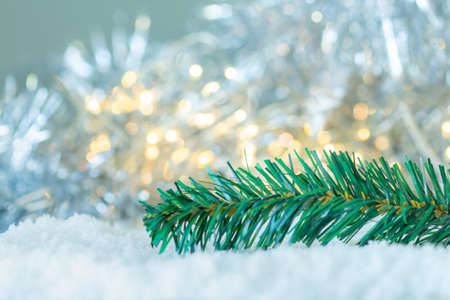 Tree Christmas on the snow with bokeh light background,