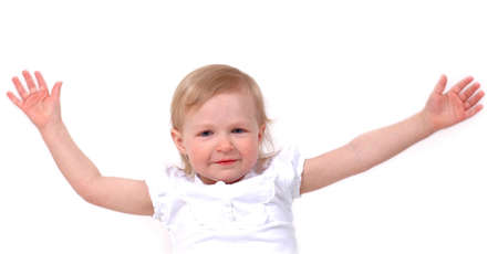 A little girl with arms open wide on white background photo