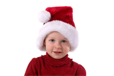 A toddler in a Santa hat photo