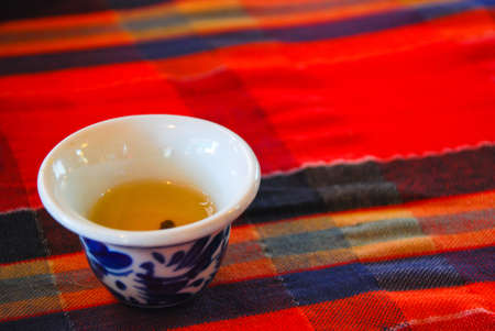 chinese tea cup: Chinese tea cup on Traditional red fabric Stock Photo