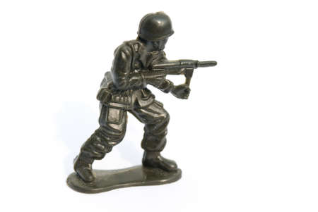 green plastic soldiers: Green Toy soldier on isolate white background
