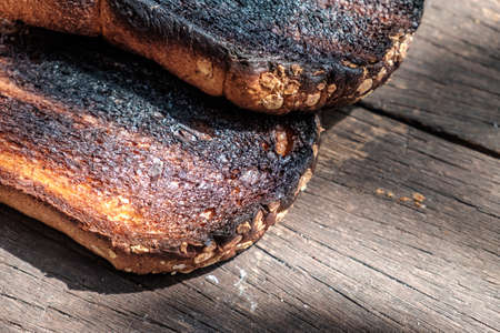 burnt toast: Crispy and Crunchy Over Burned Toasts place outdoor on wooden stool in Daylight