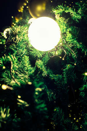 light spheres ornaments hanging on christmas tree give it dreamy atmosphere for seasonal holiday decorations stock