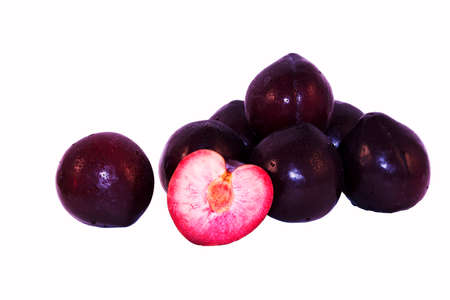 Black Plums Isolated on White Background photo
