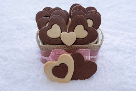 Pretty Rolled Vanilla Heart inside Chocolate Heart Sugar Cookies in a Ceramic bowl wraps with Burlap