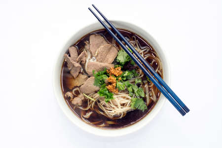 rice noodles: Thai Style Beef Rice Noodles Soup in Ceramic Bowl on White Fabric Background Stock Photo