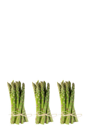 stalk: Standing Stalk of Green Asparagus with Bow tie Isolated on White Background Stock Photo