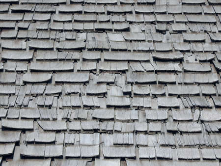 parquet floor layer: An abstract peeled old aged wooden roof shingle texture and background